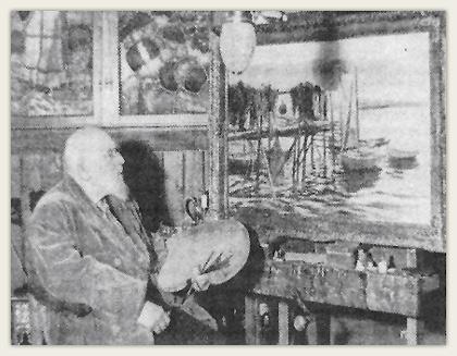 Wilhelm Peters ved staffeliet i sitt hus i Drøbak. I bakgrunnen deler av det store 4-delte glassmaleri.